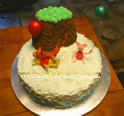 winnie the pooh baby cake with big tree and characters