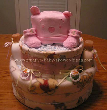 pink hat and booties winnie the pooh diaper cake