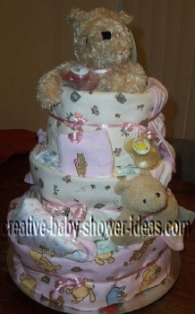 pink and white winnie the pooh diaper cake