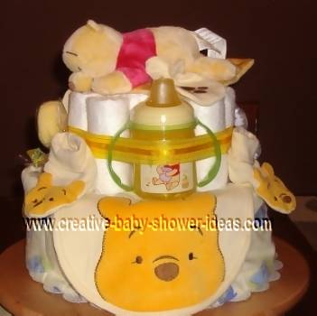 winnie the pooh diaper cake with baby items