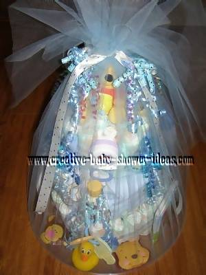 finished winnie the pooh diaper cake wrapped  in tulle