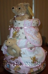 side view of pink blankets winnie the pooh diaper cake