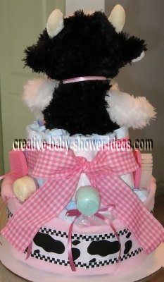 back of cow diaper cake with cute spotted ribbon