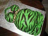 green and brown zebra belly dress cake with baby foot showing through dress