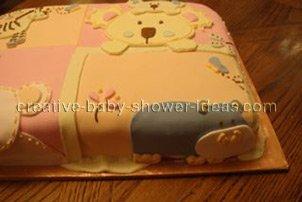 closeup of hippo animal on quilt blocks cake