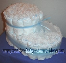 white baby bootie diaper cake tied with blue tulle