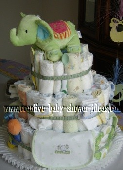 gender neutral baby diaper cake with light green elephant and decorations throughout
