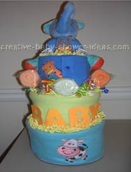 green and blue baby diaper cake with blue elephant on top and washcloth roses