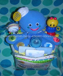 bright blue baby octopus and toys diaper cake