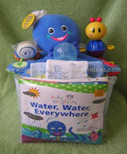 front of octopus diaper baby cake with baby einstein book