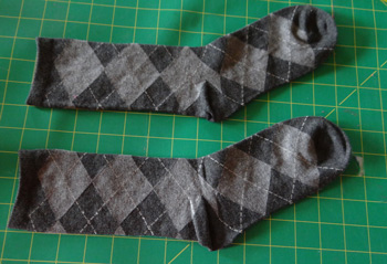 Lay out crew sized socks on cutting board
