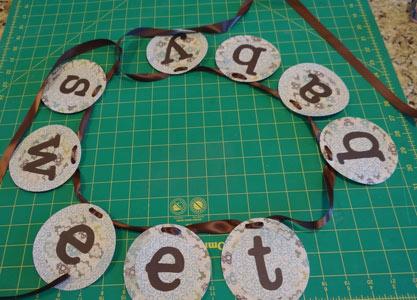 brown ribbon threaded through banner circles