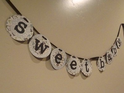 homemade green, brown and blue baby shower banner