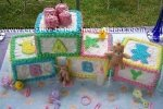 baby blocks cake trimmed in bright edge colors and baby letters on them