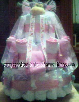 pink and white monkey diaper cake