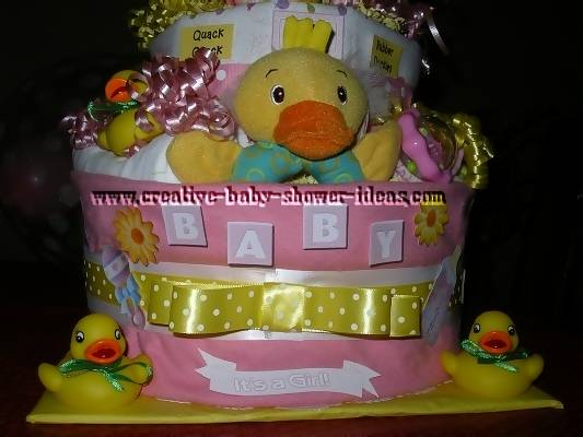 closeup of bottom layers of duck diaper cake with baby letters