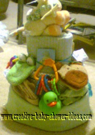 green and yellow ducky and monkey diaper cake