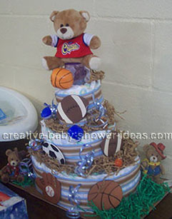 side of sports bear diaper cake with football basketball baseball and soccer ball