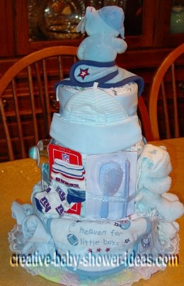back of baseball diaper cake showing baby supplies and bib