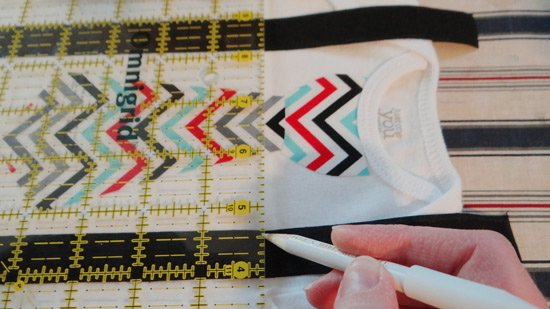 marking the sew line for the D ring on the onesies