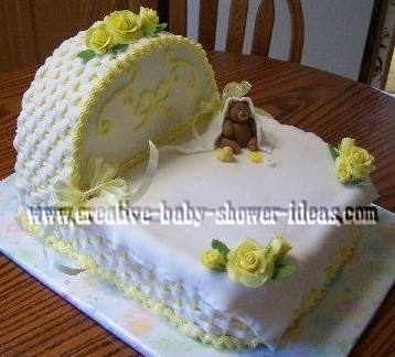 yellow and white baby shower bassinet cake