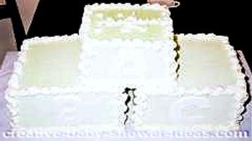 cream and white blocks baby shower cake