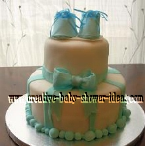 blue and white bootie baby cake
