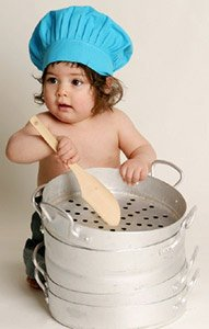 baby with cooking pot spoon and blue chefs hat