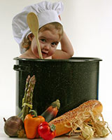 baby cook with white chef had pot and vegetables