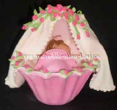 pink and white baby shower bassiner cake topper
