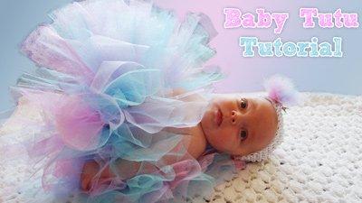 baby wearing blue, pink and purple tutu