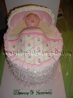baby sleeping in a bassinet cake