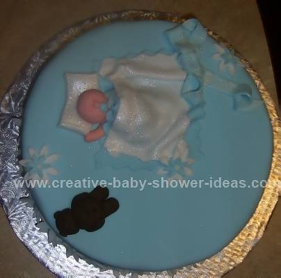 blue baby blanket cake with sparkly white baby blanket