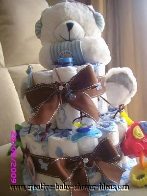 blue and brown teddy bear diaper cake