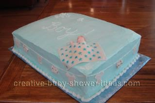 top of blue quilt cake with sleeping baby