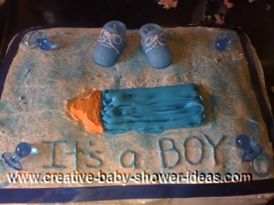 blue bottle baby shower cake