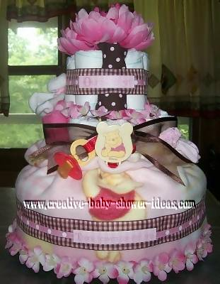 pink flower boutique winnie the pooh diaper cake