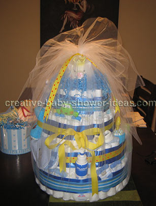 yellow and blue boy diaper cake with piggy bank wrapped in tulle