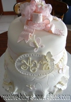 closeup of butterfly baby shower cake showing pink fondant bow