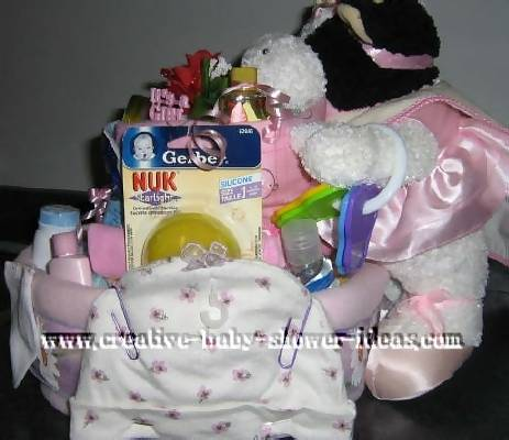 pink and white ballerina cow diaper cake