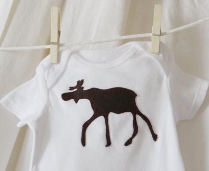 finished brown moose onesie hanging on clothesline