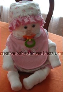 diaper baby with pink hat and bib