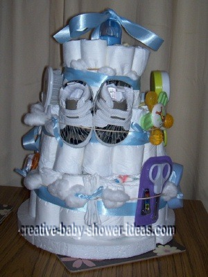 side of boy diaper cake with baby sneakers
