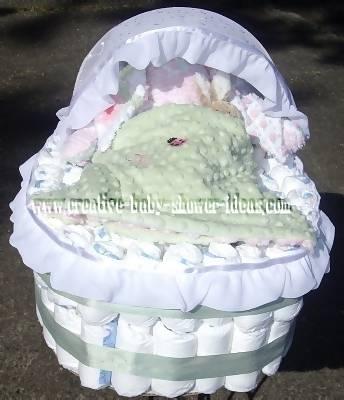 white and green diaper bassinet cake