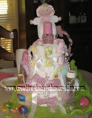 pink babies and bottles diaper cake
