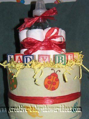 red lady bug blocks diaper cake