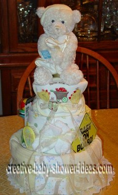 cream bear and blankets diaper cake with baby on board sign