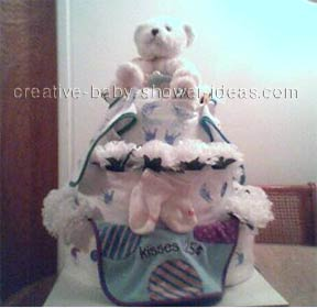 white bear diaper cake with white flowers