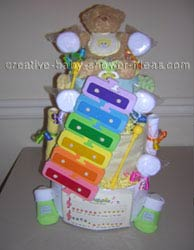 teddy bear diaper cake with xylophone toy