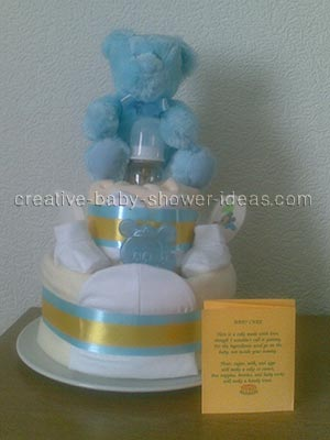 front of blue and gold bear diaper cake